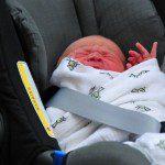 George in a babyseat